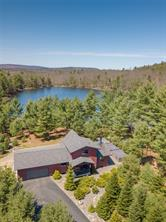 Maine Contemporary Home on a private pond in a gated community for sale in Swanville, Maine