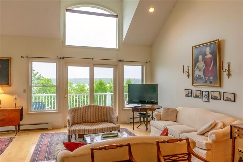 Livingroom end-unit townhouse at the ocean's edge with big views of beautiful Stockton Harbor