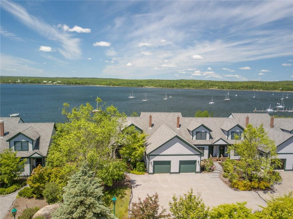 Excellent end-unit townhouse at the ocean's edge with big views of beautiful Stockton Harbor for sale on the coast of Maine