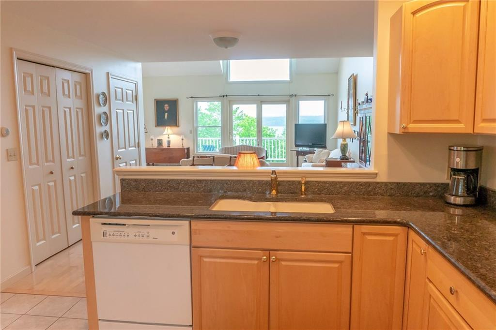 Stockton Springs Waterfront Condo for sale vaulted ceiling, gas fireplace, granite counters, hardwood floors, one-car, attached garage and two, spacious waterside decks for absolutely smashing sunsets