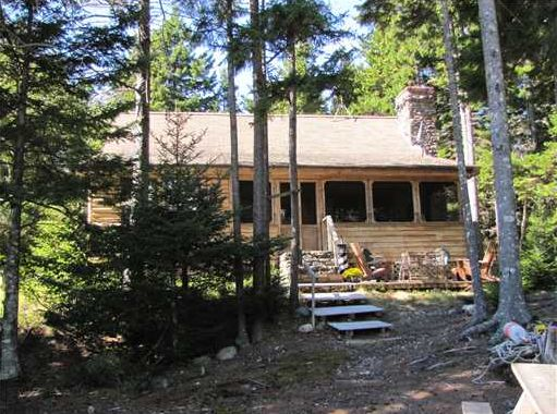Real Estate Listing - 3 bedroom, 2 bath log cabin. Stone fireplace, screened porch, underground power, tranquil views of Southeast Harbor