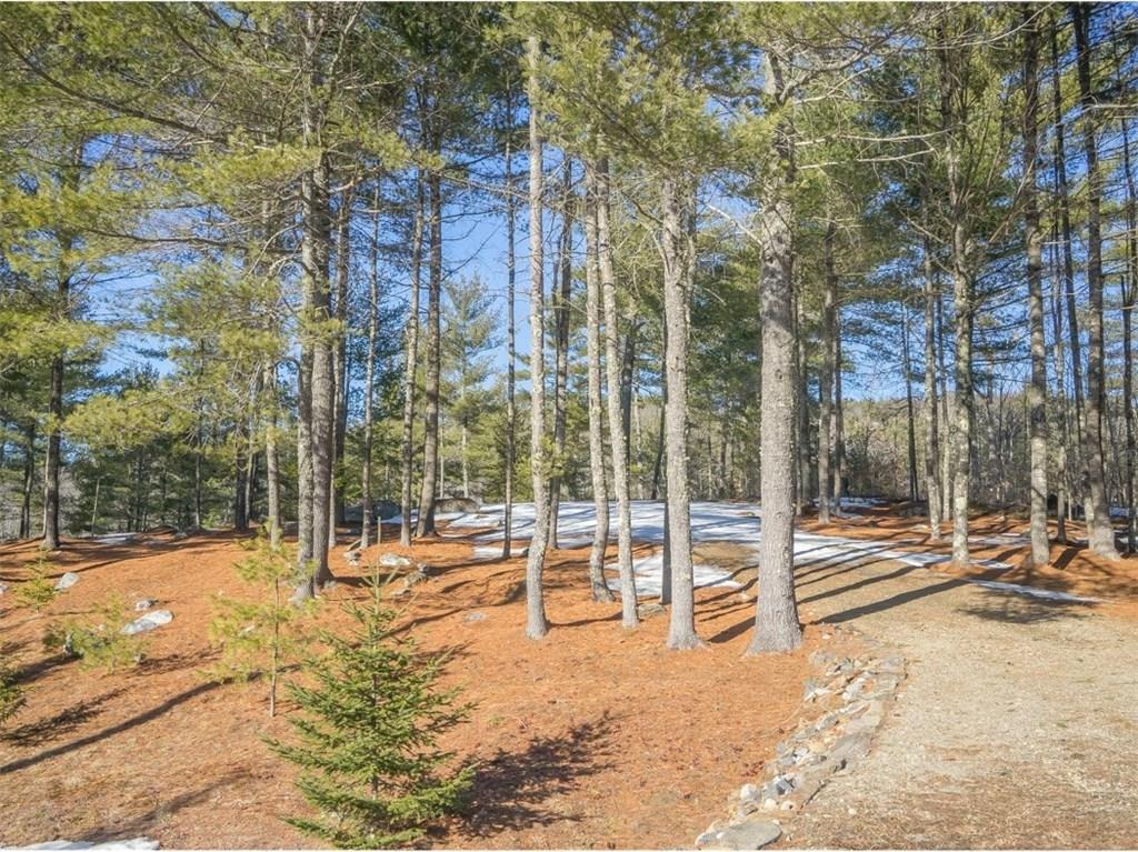 Maine buildable lot - 1.01 acres with 215 feet of waterfront for sale on private pond