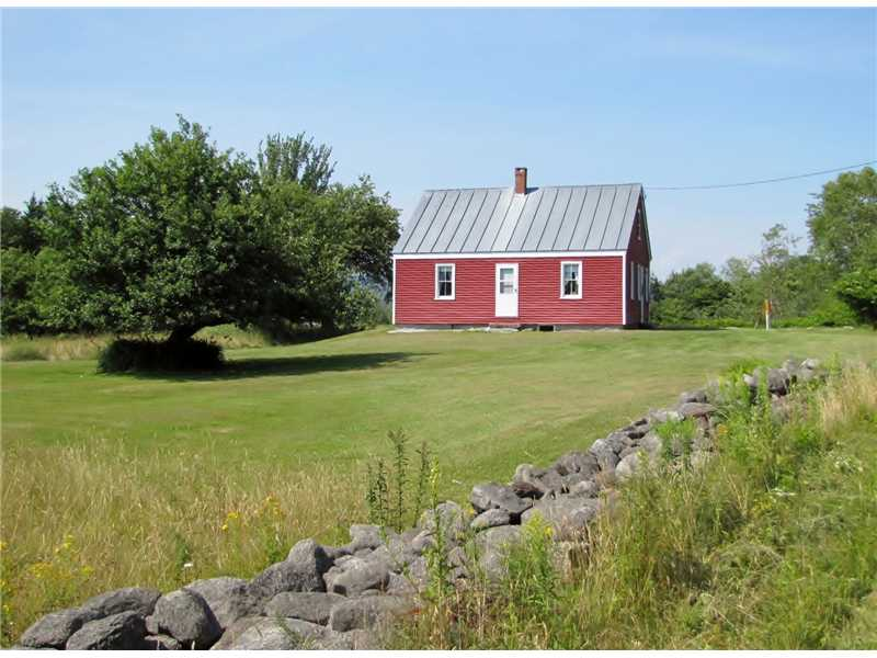 Saltwater Farmhouse with 34 acres and 2,000 ft of waterfront for sale on the coast of Maine