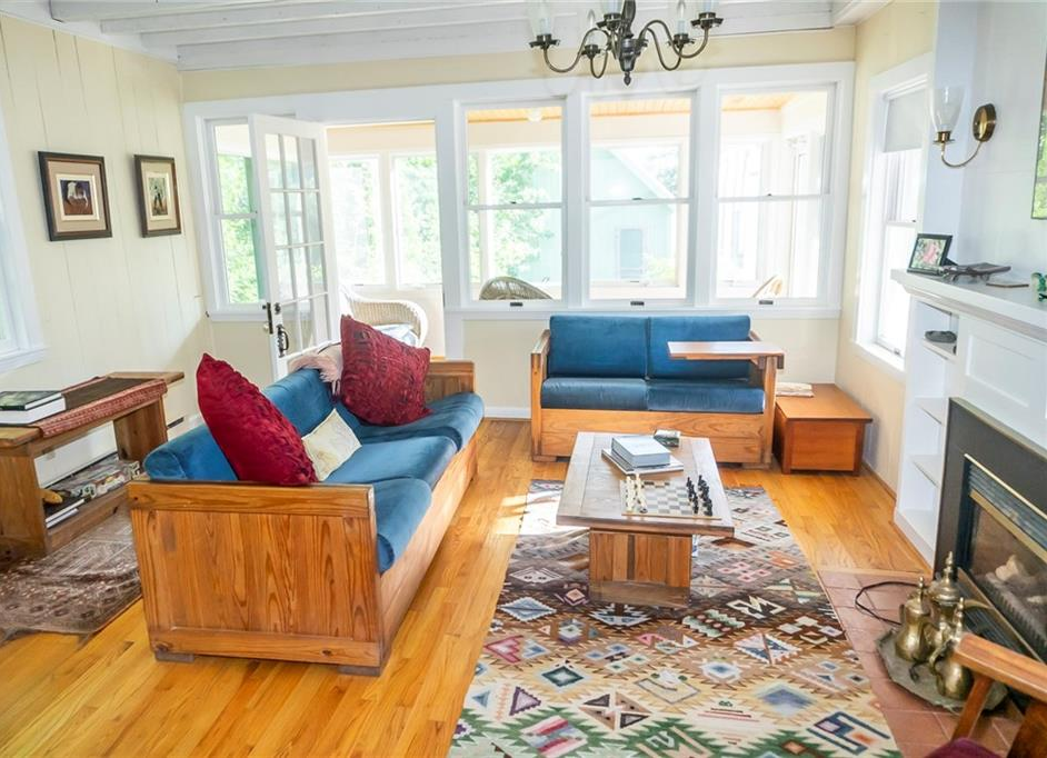 Maine Victorian 3-season cottage has 3 spacious bedroomss, a large sunny kitchen, a cozy living room with a gas fireplace, a big deck for outside 