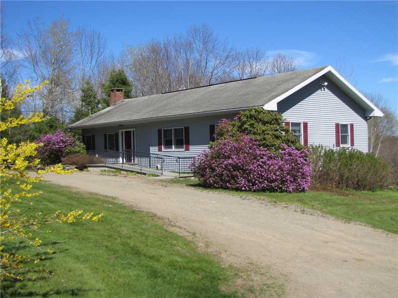 Real Estate Listing - Coastal Ranch Home with a Sun Room, Deck and 2-Car Garage - 