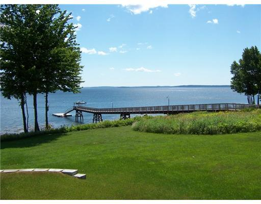 Real Estate Listing - Belfast, Maine - Beautiful oceanfront community with a shared 300' deepwater dock & float! Easy to maintain, close to town, boat mooring possible.