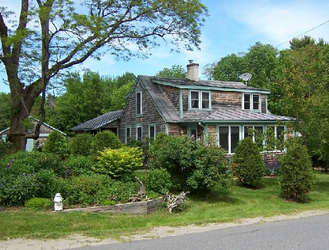 Maine Real Estate Listing - babbling brook and a three-bedroom home in move-in condition