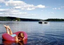 Playing on a tube on Maine lake
