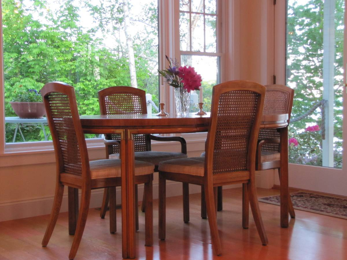 Dining area of a waterfront real estate listing on the coast of Maine with Views of Penobscot Bay in 
