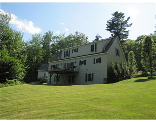 Real Estate Listing - Northport, Maine - Open floor plan, 1st-floor master BDR suite, wood stove, large deck and 2-car garage