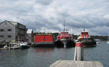 Views from Belfast Harbor of CoastWise Realty Office and Maine Tugboats